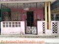 EN CUBA, VENDO CASA EN EL CENTRO DEL COTORRO PUERTA CALLE  $13,000 NEGOCIABLES