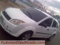 Vendo ford laser o cambio carros