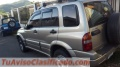 Vendo vehículo suzuki Gran vitara